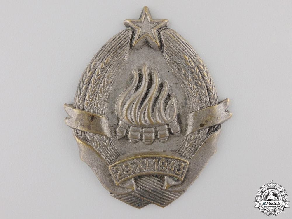 A Rare Corpus of Yugoslav National Defence Buckle, Badge & Photograph