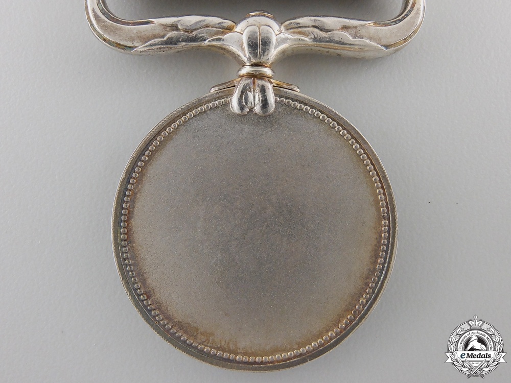 A Japanese Merit Medal (Konjuhosho); Named with Case