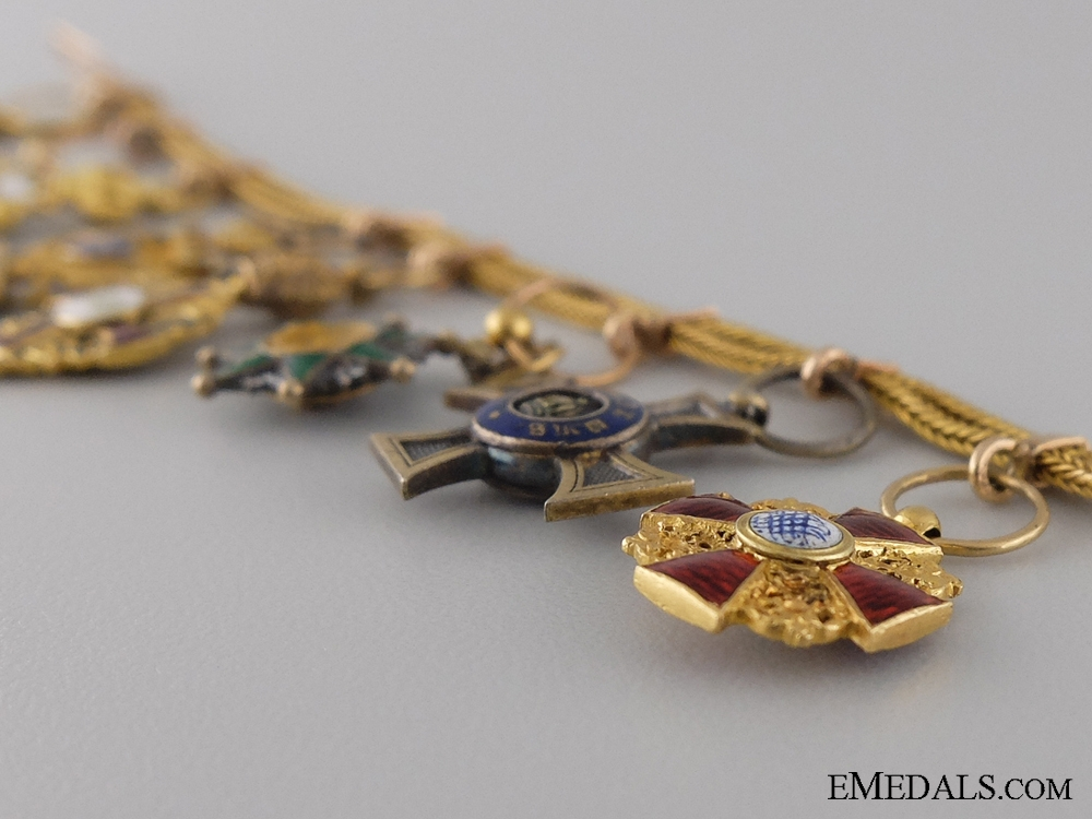 A Late 19th Century Diplomatic Miniature Set in Gold