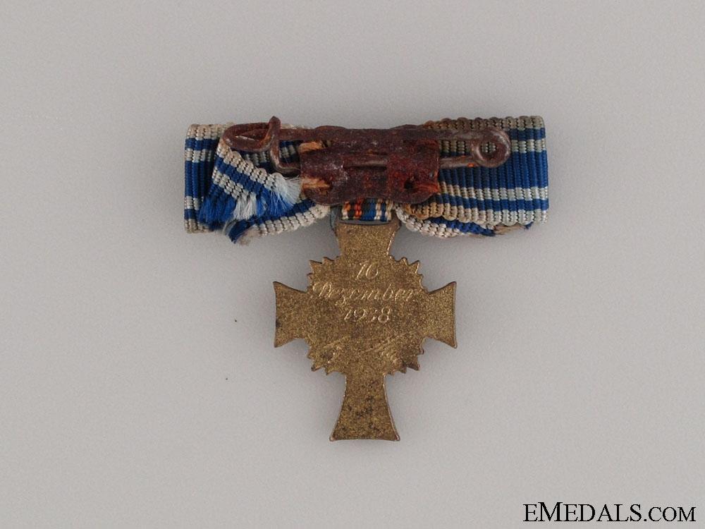 A Miniature Gold Grade Mother's Cross