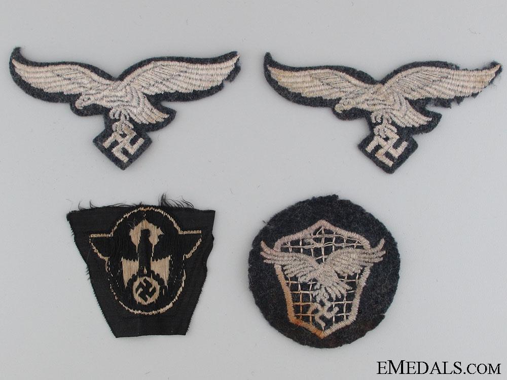 Four Pieces of Cloth Insignia