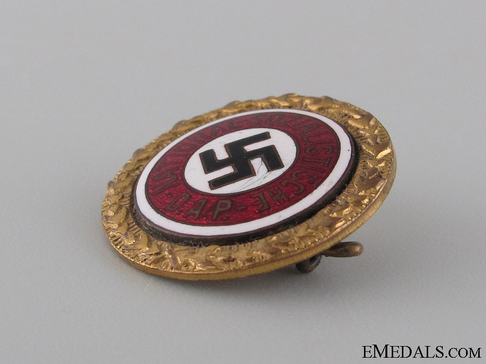 A Small NSDAP Golden Party Badge to SS Lieutenant
