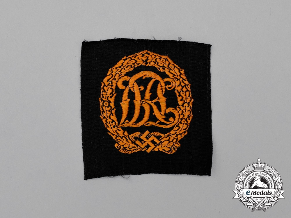 A Mint and Unissued Third Reich Period Gold Grade DRL Badge; Cloth Version