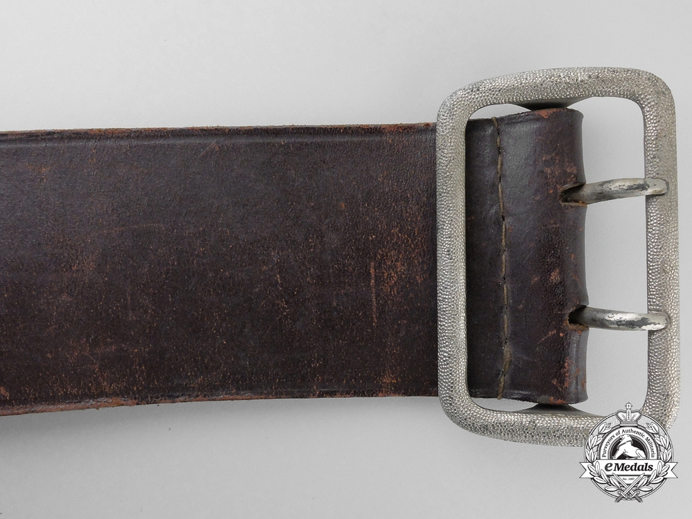 A Double Open Claw Buckle with Belt by Dr. Franke & Cie KG, Lüdenscheid