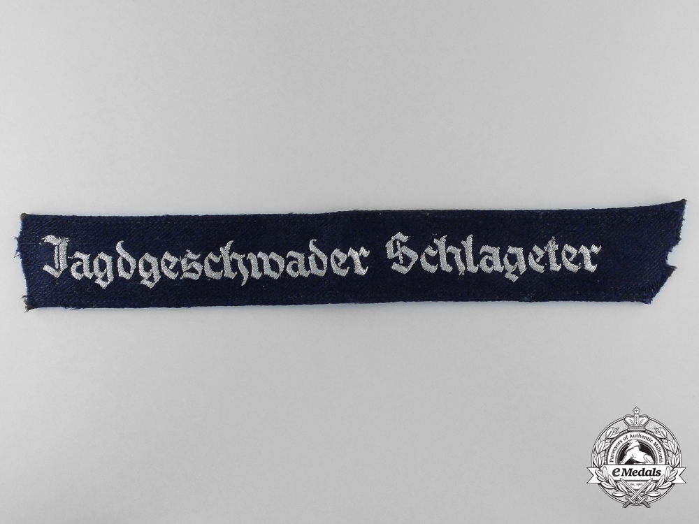 A Jagdgeschwader Schlageter Officer's Cufftitle from Fighter Ace Rolf Hermichen; 64 Aerial Victories