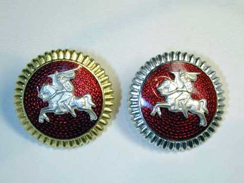 TWO CAPS BADGES
