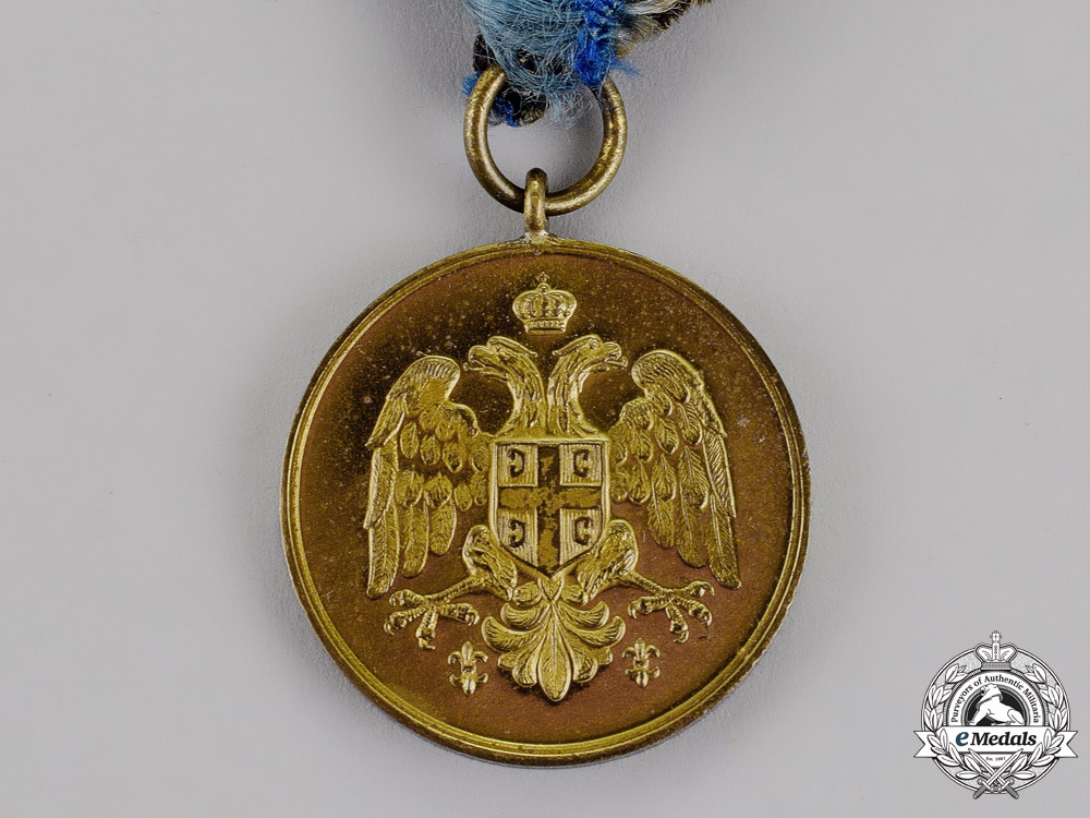 Serbia, Kingdom. A Medal for Zeal, Gold Grade, Type II with a Single Crown Between the Eagles' Heads