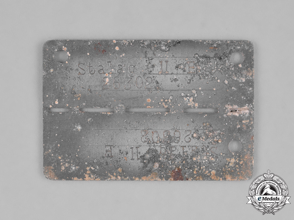 Germany, Third Reich. A Stalag II-E (Schwerin) Identification Tag, Numbered 26302