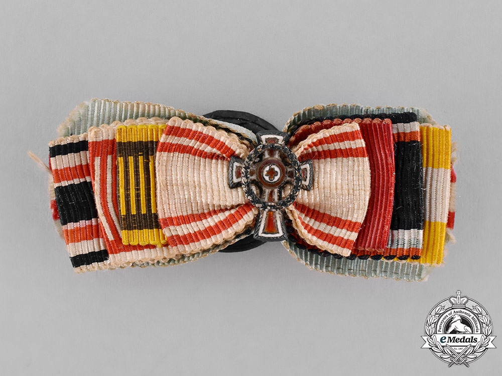Austria, Empire. A Miniature Honour Decoration of the Red Cross with War Decoration