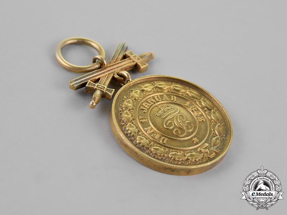 Hohenzollern, Dynasty. A Dynastic Houseorder of Hohenzollern Gold Merit Medal with Swords