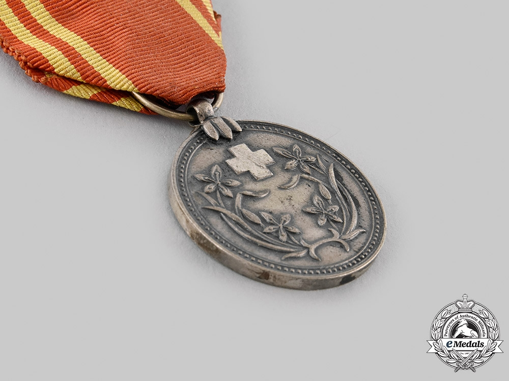 Japan, Occupied Manchukuo. A Red Cross Membership Medal