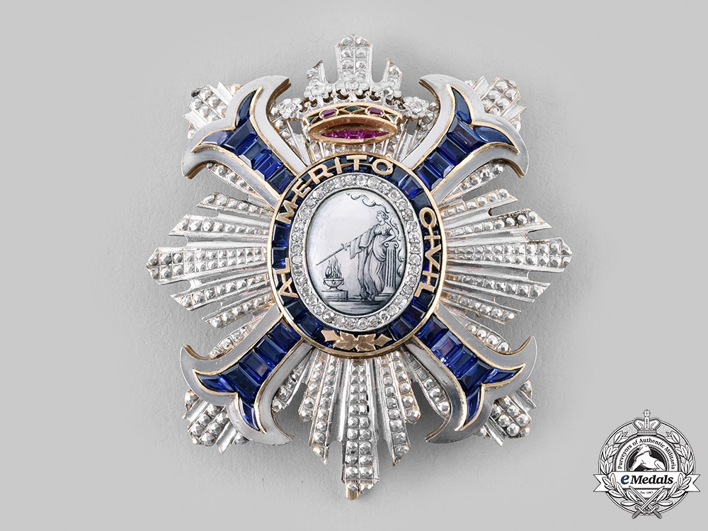 Spain, Fascist State. A Superb Breast Star in 18Kt Gold, Diamonds, Sapphires and Rubies, c.1950