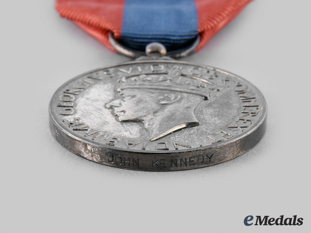 United Kingdom. An Imperial Service Medal, to John Kennedy