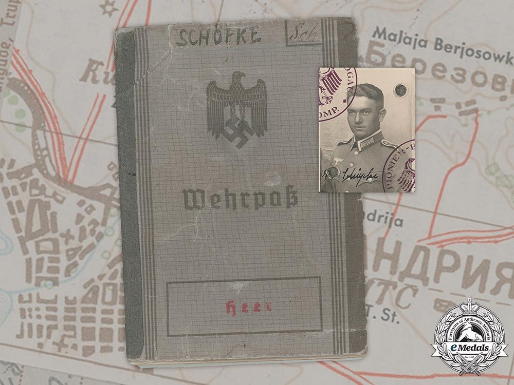 Germany, Heer. A Wehrpaß Belonging to Otto Schöpke, Bandenkampfabzeichen Recipient