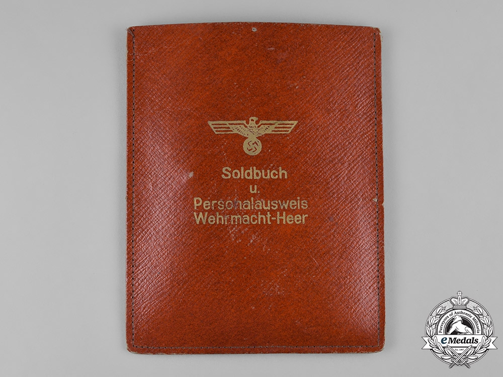 Germany, Heer. A Soldbuch & Document Group to Lieutenant Wiard Müller, Metz 1944 Cuff Title