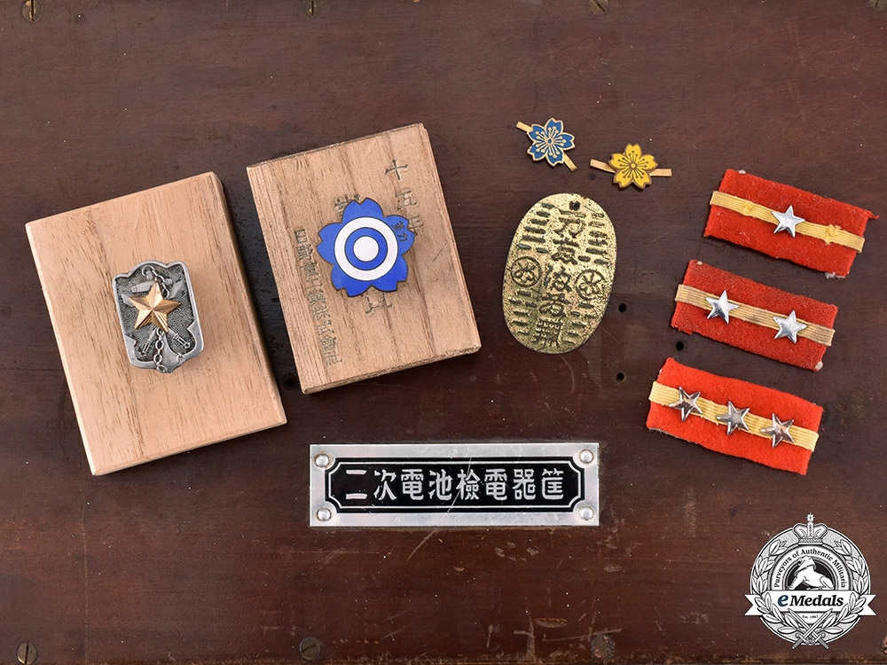 Japan. A Lot of Thirty-Four Army & Navy Insignia and Badges in a Wooden Box