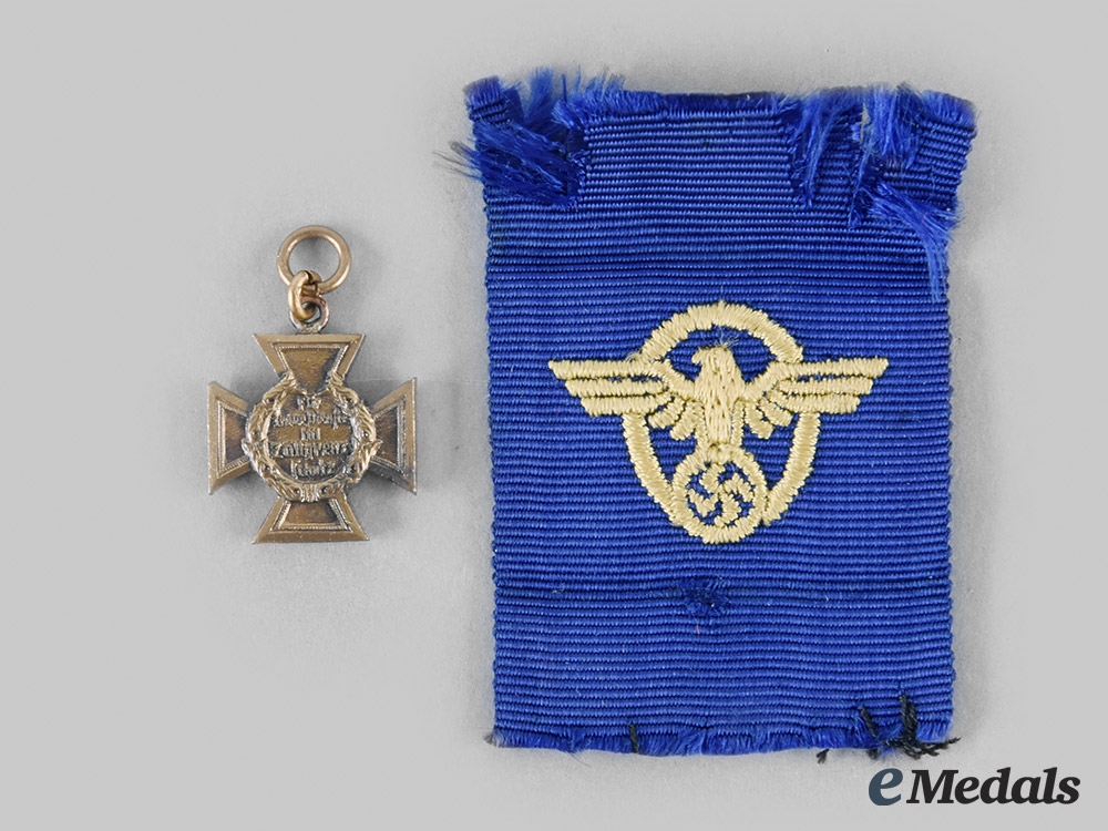 Germany, Third Reich. A Border Protection Long Service Cross, with Miniature
