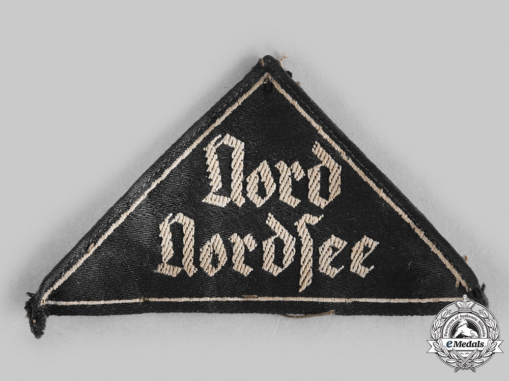 Germany, Third Reich. A League of German Girls Nord Nordsee District Sleeve Triangle