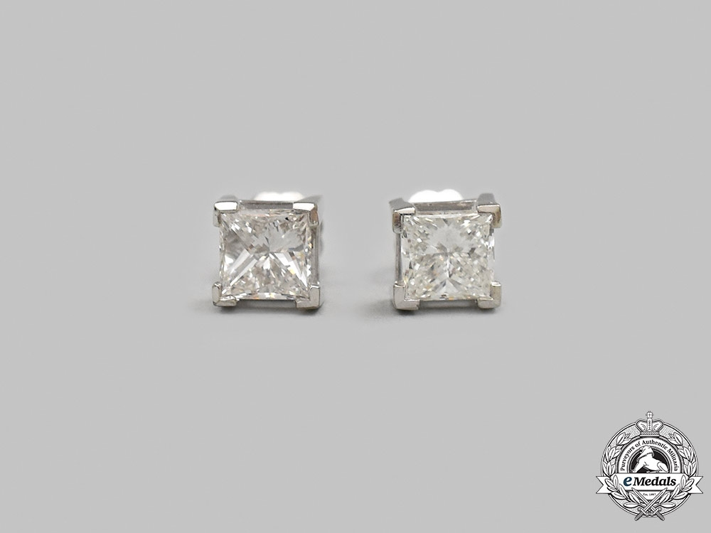 Jewellery. A Pair of White Gold Princess Cut Diamond Stud Earrings
