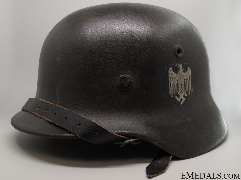 dating german helmets This helmet is a medium size, featuring a gloss black lacquer finish, typical liner and strap system, and no decals (the period photo shows two no-decal gunmetal finish rzm helmets with early ss adornment of swastika only pre-dating the award of the runes by ,df').