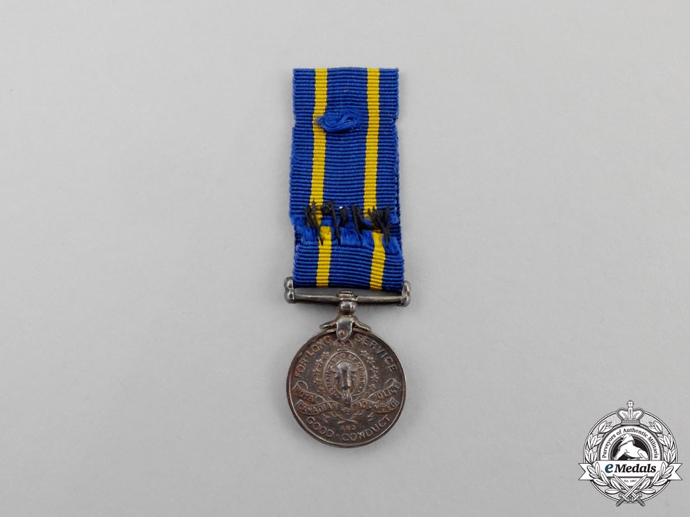 A Miniature Royal Canadian Mounted Police Long Service Medal
