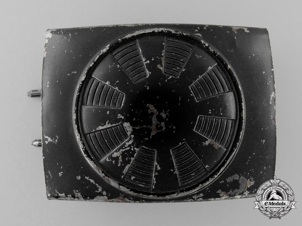 A Post-War Allied Occupied Germany Spoked Wheel Neutral Pattern Belt Buckle; Published