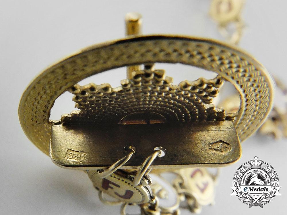 A Miniature Austrian Order of Franz Joseph in Gold
