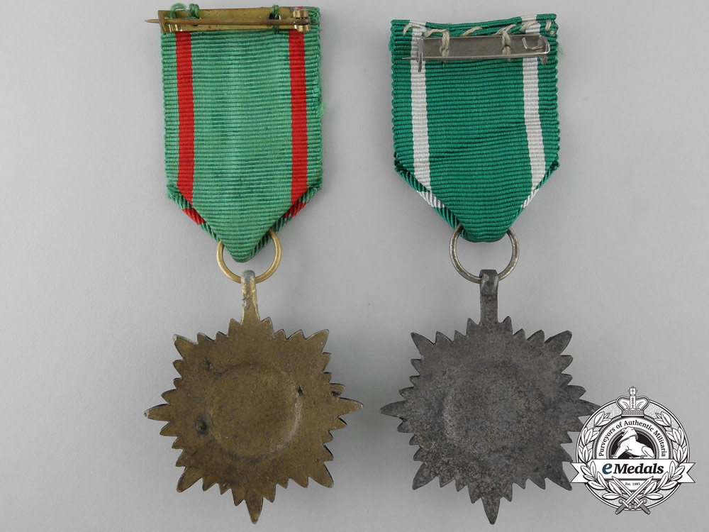 Two 2nd Class Ostvolk Decorations; Gold and Silver Grades