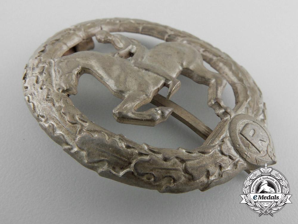 A Silver Grade German Horseman's Badge by L. CHR. LAUER NÜRNBERG-BERLIN