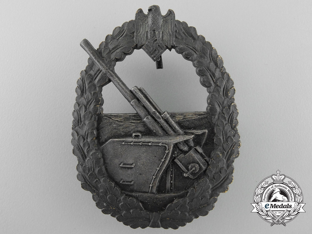 Germany. A French Made Naval Coastal Artillery Badge with Box