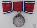 A 1935 Jubilee Medal; Ladies Bow