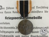 A War Merit Medal with Award Document 1943