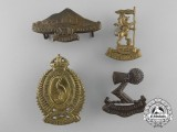 Four First War New Zealand Cap Badges