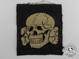 An SS Tropical Skull Cloth Insignia