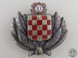 A Croatian Financial Police Cap Badge