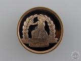 A First War British Norfolk Regiment Sweetheart Badge in Gold