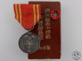 A Japanese Manchukuo Men's Red Cross Society Membership Medal