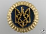 A Second War Ukrainian Auxiliary Police Cap Badge