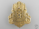 A Thai Police/Defence Force Cap Badge
