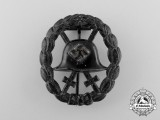 A Condor Legion Black Grade Wound Badge; Stamped Version