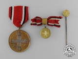 A Prussian Red Cross Medal; Complete Set
