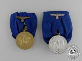 A Grouping of 3rd and 4th Class Wehrmacht Heer (Army) Long Service Awards