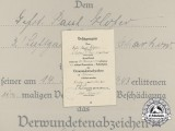 A Wound Badge in Black Award Document to Gefreiter Paul Hofer in Kholm