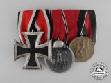 A Parade Mounted German Medal Bar of Three Medals, Awards, and Decorations