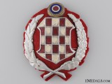 An Early Croatian WWII Period Gendarmerie Cap Badge