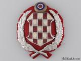An Early Croatian WWII Period Gendarmerie Cap Badge