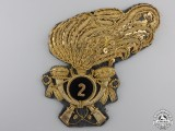 An Italian 2nd Artillery Cavalry Cap Badge