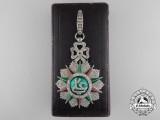 A Fine Tunisian Order of Nichan Iftikhar; Commander's Neck Badge by Halley, Paris