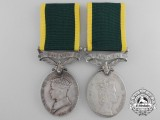 A Father & Son Efficiency Medals with Canada Scroll