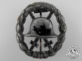 A First War Black Grade Wound Badge; Cut-out Version